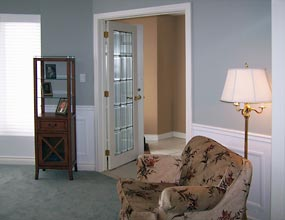 Image of living room French doors after interior design work by Distinctive Spaces.
