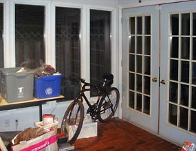 Image of the interior of a sunroom prior to interior design work by Distinctive Spaces.