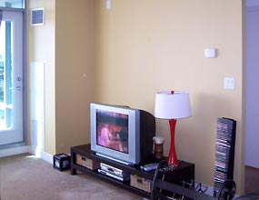 Photo of a living room in Navy Wharf, prior to redecoration by Distinctive Spaces.