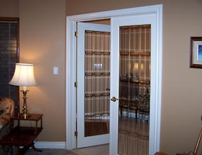 Photo of living room French doors before interior design work by Distinctive Spaces.